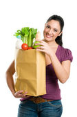 Young woman holding a grocery bag — Stock Photo