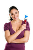 Young woman with brush for paint — Stock Photo