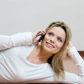 Young relaxed woman on mobile — Stock Photo