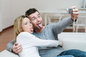 Young couple making faces and photo — Stock Photo