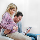 Smiling pregnant couple with ultrasound scan — Stok fotoğraf