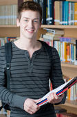 Happy young smiling student — Stock Photo