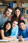 Happy students studying together — Stock Photo