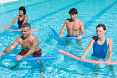 Aquagym exercise with tube — Stock Photo
