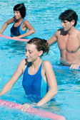 Fitness exercise in water swimming pool — Stock Photo