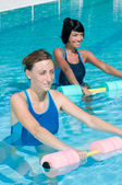 Water exercising with aqua dumbbell — Stock Photo
