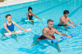 Aqua gym fitness exercise with water dumbbell — Stock Photo