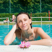 Beautiful young woman at pool — Stock Photo