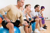 Fitness exercises at gym — Stock Photo