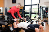 Bench press at gym — Stock Photo