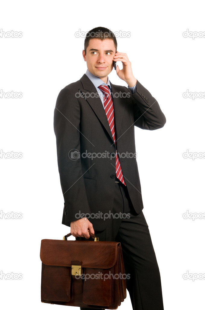 Portrait of young confident businessman with phone and working bag isolated on white background — Stock Photo #12655820