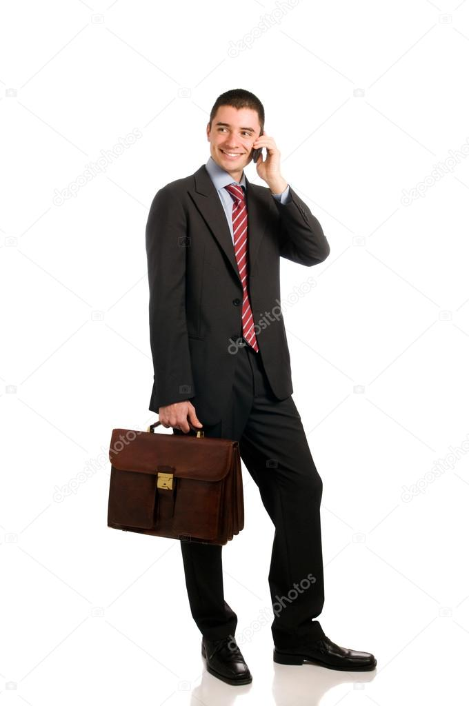 Portrait of young confident businessman with phone and working bag isolated on white background — Stock Photo #12655821