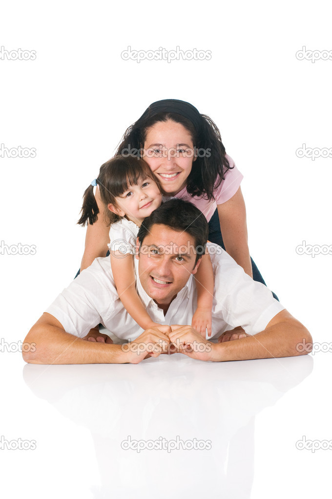 Happy smiling family lying down together isolated on white background — Stock Photo #12656557