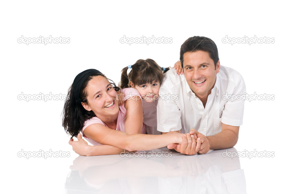 Happy smiling family lying down isolated on white background — Stock Photo #12656558