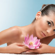 Beauty with lotus flower at spa — Stock Photo