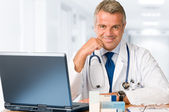 Doctor working in office — Stock Photo