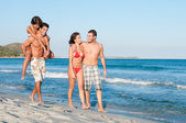 Happy couples at beach — Stock Photo