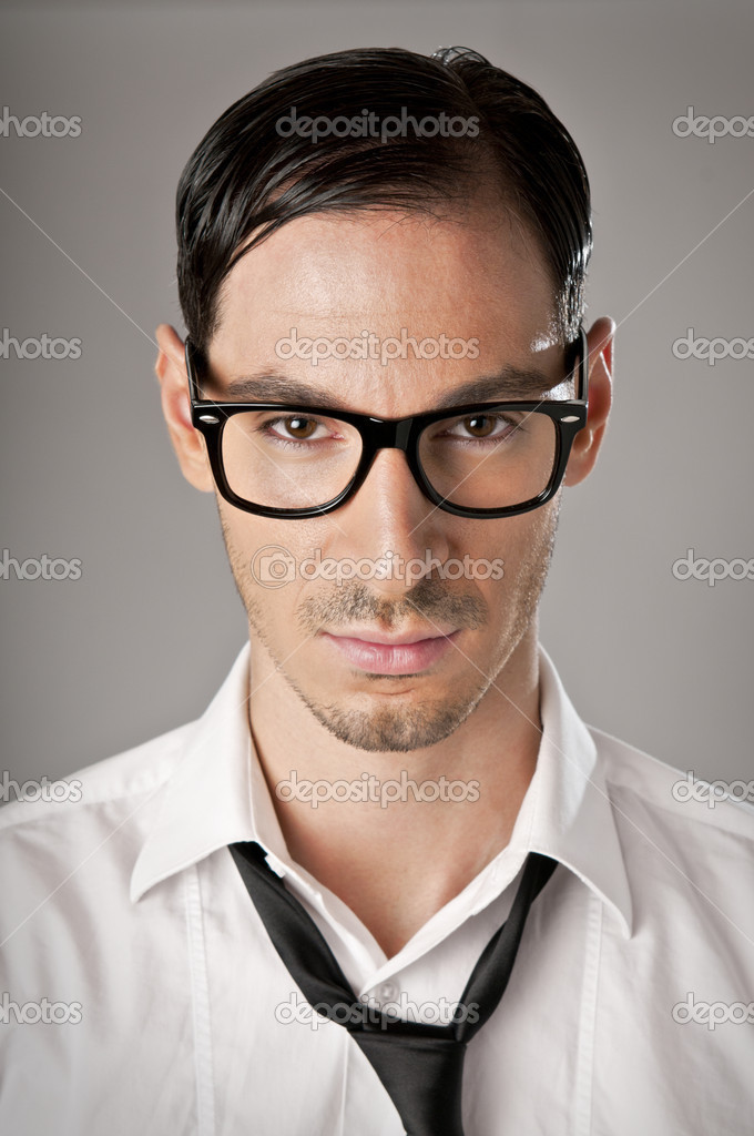 Serious pride businessman looking at camera, studio shot  Stock Photo #12661760