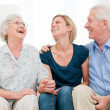 Smiling granddaughter with grandparents — Stock Photo #12760607