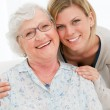 Happy young and old women — Stock Photo