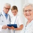 Healthy senior woman at hospital — Stock Photo #12760637