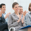 Foto Stock: Business team clapping hands