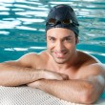 Happy man swimming — Stock Photo