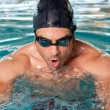 Swimming young man - Stock Photo