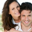 Loving couple piggyback — Stock Photo #12767936