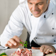 Smiling chef at work — Stock Photo #12768788