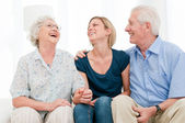 Smiling granddaughter with grandparents — Stock Photo