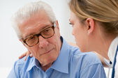 Consoling elder man — Stock Photo