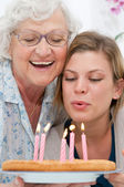 Birthday celebration with grandma — Stock Photo