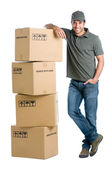 Satisfied worker with boxes — Stock Photo