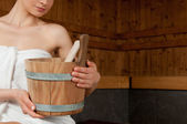 Woman with bucket at sauna — Stock Photo