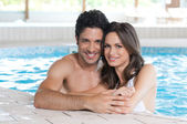 Loving couple at spa pool — Stock Photo