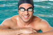 Happy athlete at pool — Stock Photo