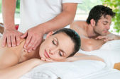Couple relaxing with massage — 图库照片