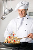 Chef cooking pasta — Stock Photo