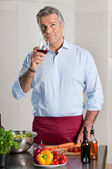 Winetasting while cooking — Stock Photo