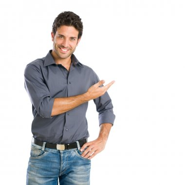 Smiling young man presenting product