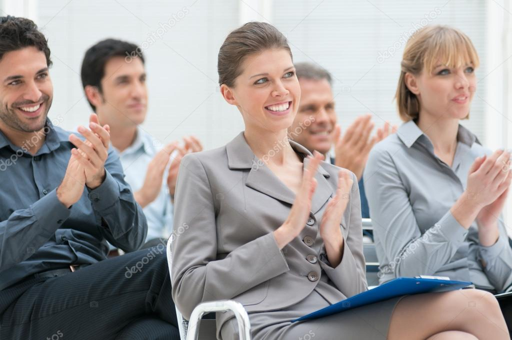 Happy business group of clapping hands during a meeting conference — Stock Photo #12767003