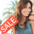 Young Woman Holding Sale Board — Stock Photo