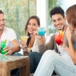 Happy Group Of Friends Drinking Juice — Stock Photo #16954879