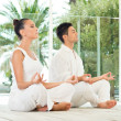 Stock Photo: Young Couple Doing Yoga