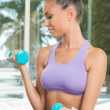 Woman With Dumbbells — Stock Photo #16956907