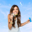 Young Woman Blowing Bubbles — Stok fotoğraf