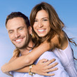 Young Man Carrying Woman On Back — Stock Photo