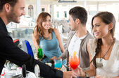 Happy Friends Drinking at Bar — Stockfoto