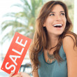 Happy Woman Holding Sale Sign — Stock Photo